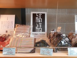 小倉織り専門店「縞縞」のロゴマーク