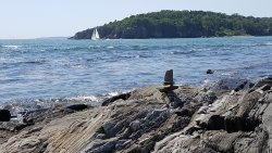 Visitors take the opportunity to make rock sclptures with the many tide washed rocks.