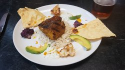 Grilled yellowtail jack, Moroccan spiced cauliflower, avocado, raita and basmati rice