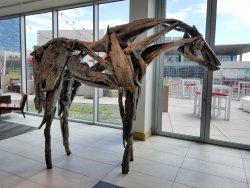 """""""Otter"""" 2014. A bronze sculpture made to look exactly like driftwood, by artist Deborah Butterfi"""