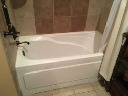 The bathtub is about four feet long. Put in a shower instead of this slip and fall waiting to ha