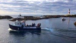 Heather Isle leaving Boddam harbour Buchanness north east Scotland