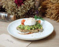"""""""Avocado Toast"""" Rye toast fresh Avocado, Smoked Salmon and Poached egg on top.  Enjoy."""