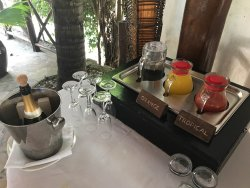 Breakfast buffet and menu card (for hot eggs) on table, included. Note the complimentary sparkli