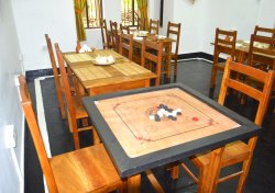 Our dining room and caram board. Meet Sri Lanka when you stay with us.