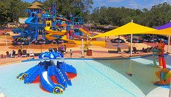 Kids splash zone and waterslide playground