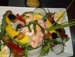 Mediterranean salad with seafood and alioli sauce