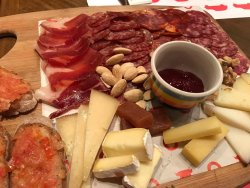 different kinds of dried ham, cheese and nuts