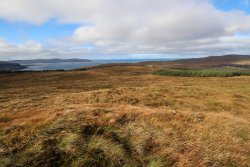 Looking North-west from Cnoc Breac: Dunvegan Head, and Western Isles in the distance