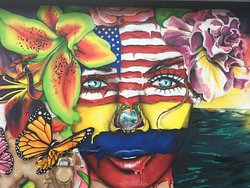 """One of the murals that is on Fuze Eatery's building, representing the 'fuzed"""" relationship."""