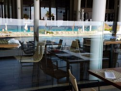 Market Grille with Pool in reflection
