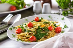 Spaghetti with extra-virgin olive oil, garlic, chilli, fresh tomato and rocket lettuce