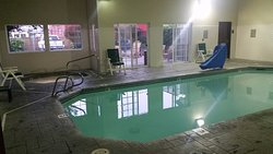 Hot tub is in the left corner and the door in the right corner is the workout closet.