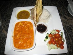 Butter Chicken Curry with Dhai, rice, Roti, Pappadums and Chutney