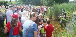 Visitors enjoy a live turtle release at Ken Reid Conservation Area.