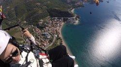 Under the wing of paragliding Rafailovici beach towards St. Stephen's in Budva Montenegro