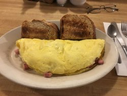 Good breakfast, local charm, HUMUNGOUS omelets!