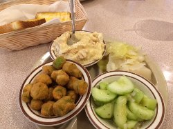 Vegetable plate: banana pudding, cabbage, cucumber salad, fried okra