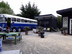 Bus where the kitchen is located and the small gift gallery