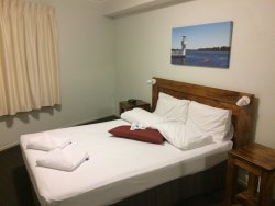 I enjoy staying there!  Nice big clean rooms overlooking Flynn's Beach!  Not far from the center