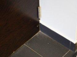 dirt and dust behind bathroom door