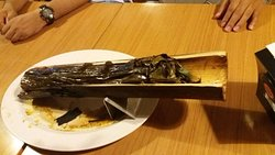 One of the favourite menu in the restaurant, fish being cooked inside a bamboo