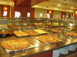 Fans of pizza: it is served here - classic, vegetable, with cheese and seafood.