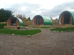 The three Inverness Glamping pods looking over Inverness