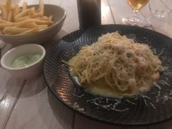 Chili crab linguine with a side dish of chips and aioli