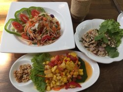 Som tom with crab, corn and larb kai