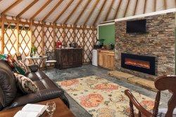 Keuka Yurt interior: 700 sq ft of cozy, spacious comfort, wifi, efireplace, TV, kitchenette