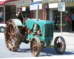 Old tractor being driven down main street (3rd Sat of each month)