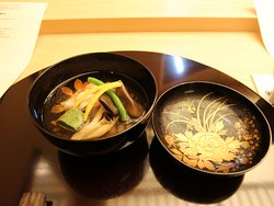 Warm Dashi with carb meat served on 200 year old lacquer bowl