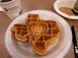 Really cute Texas waffles with honey.