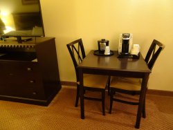 Table w/ chairs; TV on dresser