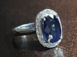 4-carat Cambodian sapphire with diamond halo set in white gold