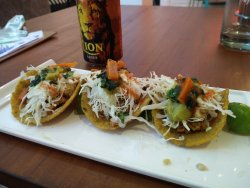 jackfruit tacos! I asked for a different topping since I don't eat cheese :)