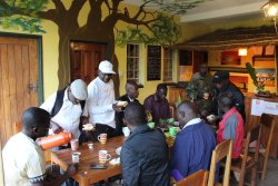 Staff having a cup of tea before a trip to Liwonde
