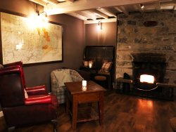 """Our cosy """"Harry's Bar"""" is great for relaxing in the evenings in front of the fire"""