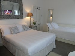 Our Deluxe En-suite room has very comfortable beds & suitable for 1-3 adults or 2 adults 2 child