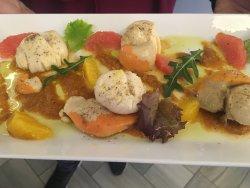 Vieiras con salsa romesco y cítricos
