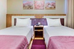 Confins Suites Hotel