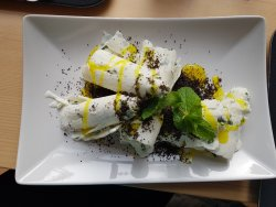 rolled ice cream with mint, poppy seed and vanilla topping
