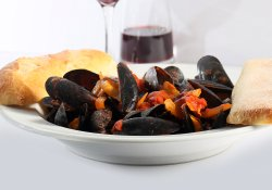 Mussels with Tomato Butter Sauce & a glass of our Red Wine