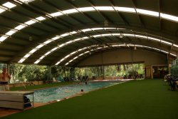 Covered swimming pool for shade in Summer