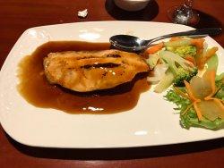 Salmon in brown sauce