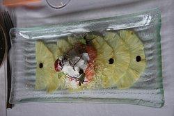 Carpaccio van ananas met creme en langoustines