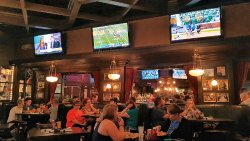 Packed dining area in Harry Caray's Tavern