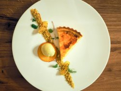 Orange and cassia bark brûlée tart with pistachio ice-cream.