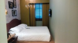 Small 13m2 King room, Parking $15, Breakfast $15, Gym great